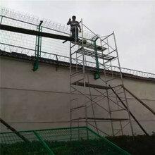 苏州墨绿��地色监狱隔离网定制图片