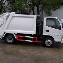 长沙市勾臂垃圾车价格,蓝牌东风多利卡压缩垃圾车a图片