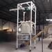 噸袋拆包機解決了吸潮結塊物料的卸料難題