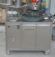 電動轉動石磨豆漿機,智能升降石磨豆漿機,研磨煮漿一體豆漿機圖片