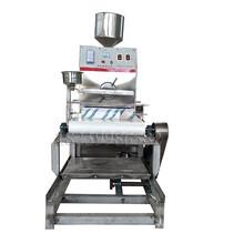 淮北大型搟面皮機全自動搟面皮機電加熱面皮涼皮機仿手工涼皮機圓形米皮機圖片