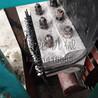 板链提升机下链轮调节丝杠加装弹簧的作用