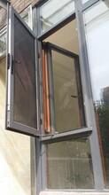 断桥封阳台/断桥门窗/铝木门窗/静音门窗/封阳台图片