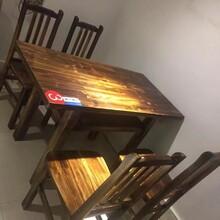 一个100平米餐馆设备火烧木餐桌椅及厨房猛火灶急处理图片