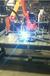長春備胎架焊接機器人,手動機器人工裝解決大問題
