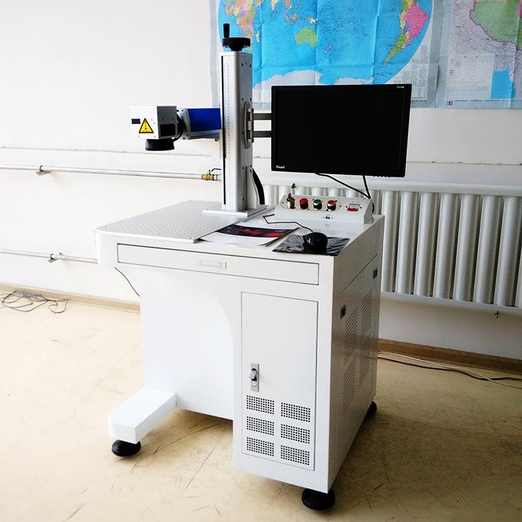 现货直供家电光纤激光打标机图片激光打码机二氧化碳刻字机