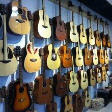 琴行倒闭,卡马吉他tom尤克里里初学者二手全新单板木吉他配件转五折