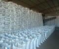 混凝土絮凝剂专用99片碱四川阿坝生产商整车送货