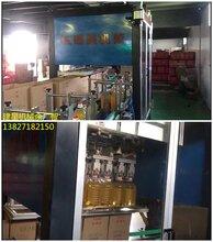 静音高效食用油自动装箱机,伺服平移抓取式,适用于瓶装/罐装产品的装箱图片
