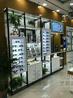 揭阳制作免漆板眼镜柜典范揭东区眼镜陈列架个性设计创新中岛台