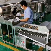 全自动鸡蛋卷机带自动卷筒自动切断机商丘福达食品机械