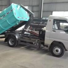 永新市楚飞牌CLQ5040ZXX4BJ型国四柴油勾臂垃圾车车厢可卸式垃圾车环卫单位清运的拳头图片