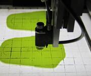 黑金刚全自动划线机通过印线组件全自动完成印线且自动将承印物收集处理,智能化、自动化图片